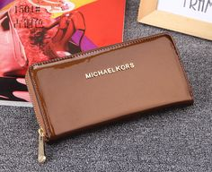MK patent leather wallet brown
