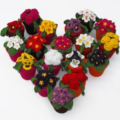 Colourful flowers designed and crochet -ed by me!  www.facebook.com/RoseCottageCrafts