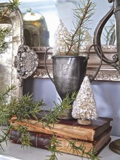 Chateau Chic - Trophy cups and bottle brush trees on the mantel
