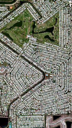 """Captivating Satellite Images of Earth: """"Barefoot Bay Development, Brevard County, Florida"""" - photo from Daily Overview, via Yatzer"""