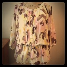 Gorgeous Ellen Tracy peplum Gorgeous Ellen Tracy top with pink and brown flowers. The pearl buttons make this piece so classy!! Worn (maybe) once Ellen Tracy Tops Blouses