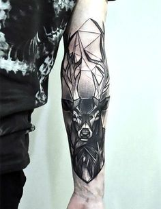 Black geometric deer's head on the arm. Awesome tattoo for men. Style: Geometric. Color: Black. Tags: Cool, Best, Popular, Beautiful, Awesome #armtattoosmen