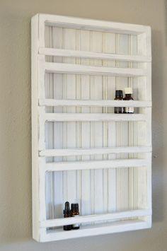 Vintage White Wood Essential Oil Display Rack, 4 Shelves, Wall Hanging by PierceBuilt on Etsy https://www.etsy.com/listing/228101705/vintage-white-wood-essential-oil-display