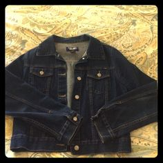 Dark blue jean jacket The everyday dark blue jean jacket that goes with everything! Barely worn because I have another one just like it. This closet staple is nicely tailored with flattering stitching along the front and back with cute silver buttons. Jackets & Coats Jean Jackets