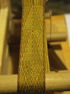 Tablet Weaving. Ravelry: bowie's Bag Strap (Green, Yellow, Brown)