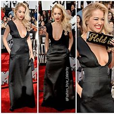"""FASHION FROM MTV MOVIE AWARDS 2014#RitaOra holds up her clutch which gives very specific instructions, """"#Hold It,"""" on the red carpet at the #2014 #MTVMovieAwards held at the #NokiaTheatre on #Sunday (#April 13) in #LosAngeles.#Rita is wearing a #BarbaraCasasola #dress, #GiuseppeZanotti #shoes, #EdieParker #clutch, and #LorraineSchwartz #jewels.#fashion #style #celebrity #black #gown #dress #calvinharris #boyfriend #music #movie #blonde... - Celebrity Fashion"""