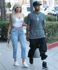 Kylie Jenner heads to Escala in Los Angeles for lunch with boyfriend Tyga in Good American jeans, a crop top and Puma Basket Classic sneakers on November 8, 2016