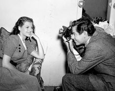 "mrglennford: """"Glenn Ford snaps Rita Hayworth's picture on the set of The Lady in Question, 1940. "" """