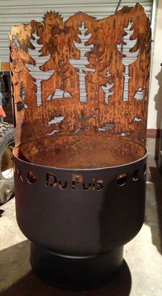 Fire pit made out of old water pressure tank. Plasma cut design into back and cutout trees reapplied to interior to give a 3D surface. Made for my sister and brother-in-law.