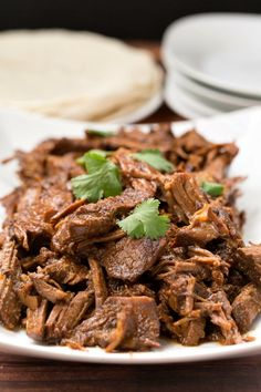 Slow cooker sweet and spicy beef  is so good and so easy to make!