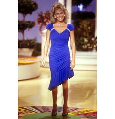 Vanna in an asymmetrical skirt on the set of Wheel of Fortune.