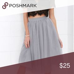 """✨HOST PICK ✨pretty tulle skirt Beautiful fully lined skirt   Such a girly girl piece!   Never worn  Perfect for the holiday season 🎄☃️❄️🎁  Fits true to size with an elastic waist  Next day shipping   Approximately 28"""" side seam (Measured from the waist to the hem of the garment.) 100% Polyester Hand wash cold water. No bleach. Hang to dry. Do not iron. Model is 5'7 with a 32"""" bust, 25"""" waist and 36"""" hips. Boutique Skirts Midi"""