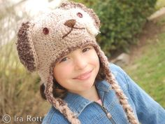 Handmade crocheted puppy dog hat for kids.  This puppy dog hat with ear flaps and braids has the most adorable puppy look