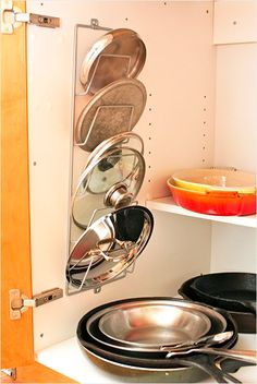 Magazine rack is perfect for lids. I looked all over for a pan lid rack and could not find one not long ago. This is an easy fix.