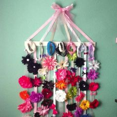 All this is is a peg rack with ribbons stapled behind to display bows. What makes it look professional, is the ribbons/bow top decor: which doesn't even, of course, need to support the board...