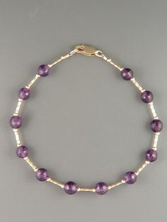 Amethyst Bracelet - 6mm round faceted stones with twist beads