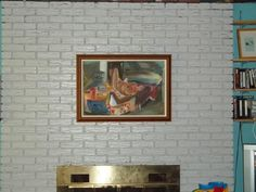 How to hang a picture on brick