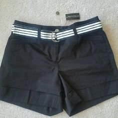 NWT - WHITE HOUSE BLACK MARKET SHORTS NWT - WHITE HOUSE BLACK MARKET SHORTS IN BLACK WITH BLACK AND WHITE BELT, 2 FRONT POCKETS AND 2 SNAP BACK POCKETS. CUFFED LEGS AND EXTRA BUTTON WITH TAG.  SIZE 4 White House Black Market Shorts
