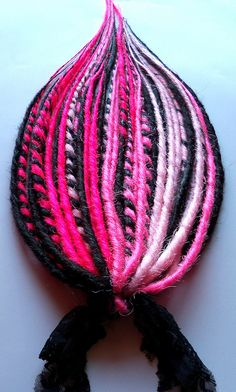 Hot pink, pink, light pink and black lace tie in dread fall from damnationhair.com