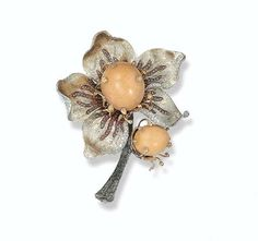 A melo pearl, diamond and pink sapphire flower clip brooch.
