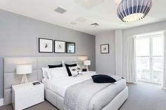 Dreaming in Color: 8 Gorgeous Gray Bedrooms | Not a fan of dark walls? Looking for something softer and lighter? It's OK, you can still go gray. I find that gray is one of the few hues that's pleasing no matter how light or dark you go. Even the lightest shades will never read as pastel or thin and one-note. This super-soft gray adds a layer of color and contrast to this soothing bedroom.