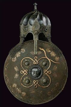 Not strictly Hungarian but the Ottoman inhabited Hungary so its relavence to style and motif found in Hungarian culture is strong. The century style turban helmet and sipar (shield), century. Ancient Armor, Medieval Armor, Style Turban, Chateau Moyen Age, Samurai, Armadura Medieval, Swords And Daggers, Arm Armor, Ottoman Empire