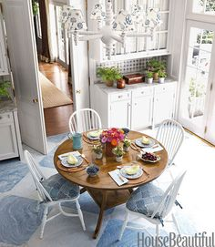 The kitchen walls and cabinets are painted in Benjamin Moore Aura in Distant Gray.   - HouseBeautiful.com