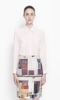 """karla spetic. white blouse, """"city/building landscape""""- skirt."""