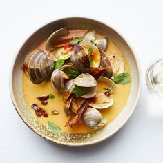 Learn to make these quick Asian-style clams in coconut broth at Food & Wine.