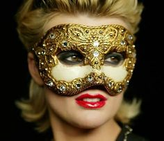 Biba Binoche in a gold mask. Happy Mardi Gras!