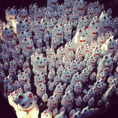 "Goutoku-ji in Tokyo is guarded by ""maneki-neko"" (""welcoming cat"")."