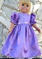 Lilac satin gown with beaded organza bodice.