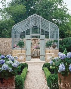Pam Pierce designed this stunning backyard greenhouse for Chateau Domingue's proprietor Ruth Gay