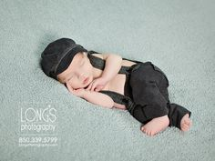 Tallahassee family and baby photographer, Linda Long of Long's Photography, creates sweet images of newborn baby boy snuggled into soft blue blanket with dapper grey overalls and cap