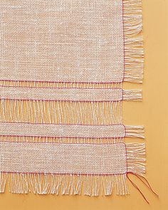 Loose Linen or burlap fringed table cloth. So easy to do!