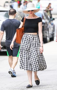 Anne Hathaway in a gingham skirt and knit crop top