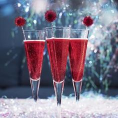Christmas Champagne: Raspberry Fizz! 1 shot Vodka, 1/2 shot raspberry liqueur, & Champagne. Place ice cubes in a champagne flute. Add vodka and raspberry liqueur. Top it up with some champagne and add a couple of berries to gussy up your drink!
