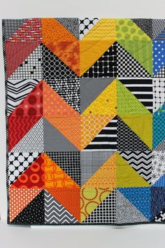 "Modern Baby Quilt ""Olivia"" Contemporary Geometric Triangle Pattern in rainbow colors; Baby, Toddler, or Lap Quilt, Play Mat; Wall Hanging"