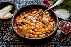 In New Mexico, there is abundance and generosity and plenty of comfort food at holiday parties Posole, the savory and hearty, rather soupy stew made from dried large white corn kernels simmered for hours, is traditional and easy to prepare Stir in a ruddy red purée of dried New Mexico chiles to give the stew its requisite kick