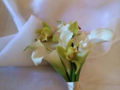 Calla lilly and orchid bouquet www.entirelybridal.co.uk , www.facebook.com/entirelybridal