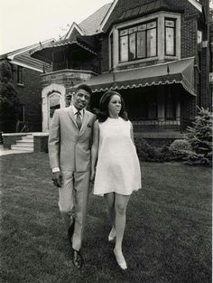 """View of singer Florence Ballard and husband Thomas Chapman posing in front of brick house. Stamped on back: """"Detroit Free Press, Ira Rosenberg."""" Handwritten on back: """"Florence Ballard. African American Fashion, African American Culture, Black Love, Black Is Beautiful, Black Art, Detroit History, Vintage Black Glamour, Famous Black, Black History Facts"""