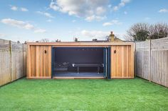 The painted walls in this chill-out room portray a luxury feel, and allow the garden room to appear bigger and more modern in design and appearance. Backyard Office, Backyard Patio Designs, Garden Office, Outdoor Office, Garden Bar Shed, Summer House Garden, Gym Shed, Man Cave Shed, Man Cave Room