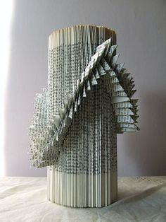 book sculpture, I think it cool how the mad art by folding and manipulating pages of a book.