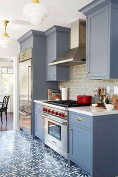 Benjamin Moore Wolf Gray a blue-grey painted kitchen cabinets with patterned floor tile and gray subway tile backsplash.  Interior design by Ginny Macdonald for Emily Henderson.