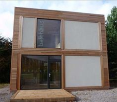 Ultra-modern strawbale house. I have not seen a strawbale house that looks like this one before!