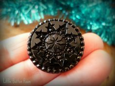 Vintage black glass snowflake button at  facebook.com/littlebuttonroom