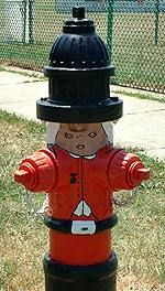 I grew up in South Bend, Indiana and for the bicentennial year, all the fire hydrants were painted wearing uniforms of soldiers from the American Revolution.  It was one of the first cities to paint all their hydrants and received national coverage.