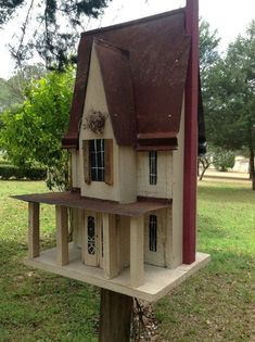 This birdhouse is a Victorian Two Story with a majestic center gable, and wrap-around porch. This is a little masterpiece, Ellington Hall. Ellington Hall is the largest birdhouse that Mr. Nye builds. Dimensions are: 24 tall, 14 long, 11 wide. The birdhouse is built by Mr. Nye, a