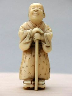 Blind man ivory netsuke signed Tomomasa his is a very charming Marine ivory Netsuke of a blind monk leaning on his stick.Carved by Tomomasa Born 1848 he was a pupil of Tomochika.