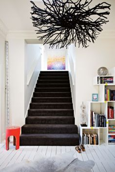 Stairs The custom light from Dr. Illuminate and Mance Design's 'Hedgehog' light add a sense of drama.
